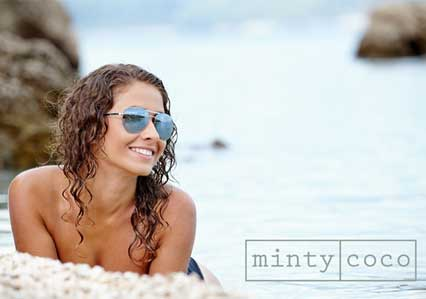 Girl on beach with white teeth and healthy smile